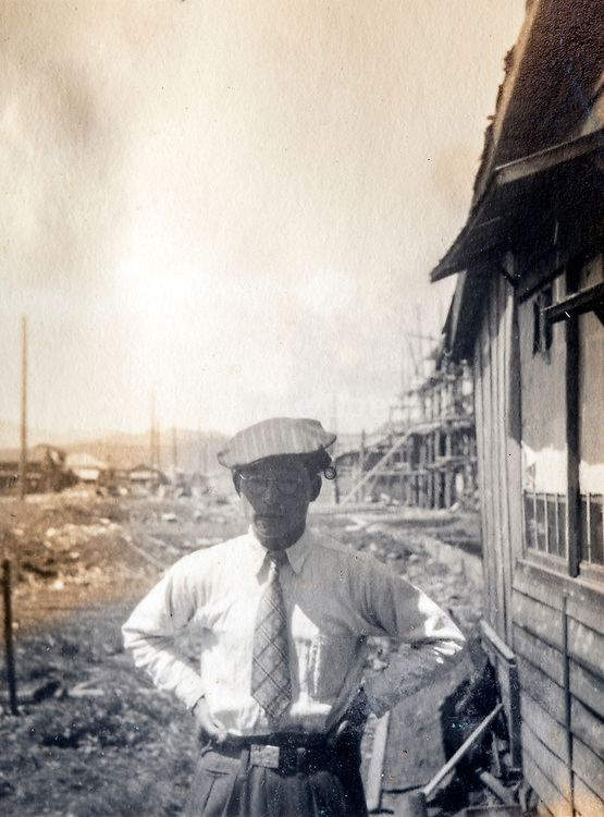 man posing on a housing construction site Japan ca 1950s