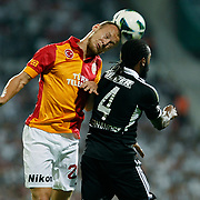 Besiktas's and Galatasaray's Semih Kaya (L) during their Turkish Superleague soccer derby match Besiktas between Galatasaray at the Inonu Stadium at Dolmabahce in Istanbul Turkey on Thursday, 26 August 2012. Photo by TURKPIX