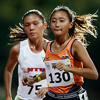 Vanessa Lee (right) of National University of Singapore overtakes Nicole Low of Nanyang Technological University with two laps remaining during the women's 5000m event. (Photo © Lim Yong Teck/Red Sports) The 2018 Institute-Varsity-Polytechnic Track and Field Championships were held over three days in January.<br /> <br /> Story: https://www.redsports.sg/2018/01/15/ivp-day-one/<br /> <br /> Story: https://www.redsports.sg/2018/01/18/ivp-day-two/<br /> <br /> Story: https://www.redsports.sg/2018/01/23/ivp-day-three/