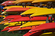 Colorful Kayaks stored for winter in Adirondack Mountains.