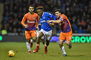 Portsmouth Forward, Jamal Lowe (18) challenges Northampton Town Defender, David Buchanan (3) for the ball during the EFL Sky Bet League 1 match between Portsmouth and Northampton Town at Fratton Park, Portsmouth, England on 30 December 2017. Photo by Adam Rivers.