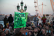 Thousands of Extinction Rebellion activists took over 5 bridges in Central London and blocked them for the day, November 17 2018, Central London, United Kingdom. Westminster Bridge; large crowds blocked to bridge all day with music and speakers and sit-down. Around 11am people on all bridges sat down in the road and blocked traffic from coming through and stayed till late afternoon. The actvists believe that the government is not doing enough to avoid catastrophic climate change and they demand the government take radical action to save future generations and the planet. Many are willing to be arrested peacefully protesting and up to 80 were arrested on the day. Extinction Rebellion is a grass root climate change group started in 2018 and has gained a huge following of people commited to peaceful protests and who ready to be arrested. Their major concern is that the world is facing catastropohic climate change and they want the British government to act now to save future generations.
