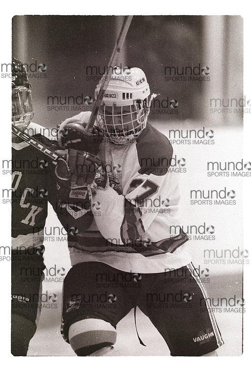 """If you wish to purchase this image, please contact us at info@mundosportimages.com quoting file name """"19961010_SB_UWOb&W_127.JPG"""" and we will clean the image before sending preparing it for sale to you. This is one of several thousand """"raw"""" black and white negative scans, each of which will need to be prepared for printing individually, which could take some time. Your understanding is appreciated...(October 10, 1996) The University of Western Ontario Mustangs men's hockey team   played at Thompson Arena in London, Ontario. Photograph copyright Sean Burges / Mundo Sport Images."""
