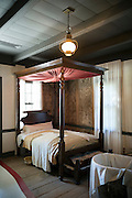 Bedroom four poster bed at Vermilionville history museum of Acadian (Cajun), Creole, Native American culture, Louisiana USA