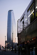 Seen from the City of London, One Blackfriars (one of the capital's newest skyscrapers) rises above a London bus during the evening rush-hour, on 27th February 2021, in London, England. Located on Bankside, the south bank of the river Thames, the development is a 52-storey 170m tower whose uses include residential flats, a hotel and retail.