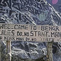 NEPAL, HIMALAYA. Local sign asking tourists to respect Tibetan Buddhist mani stone.