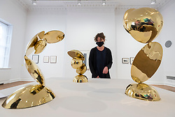 "© Licensed to London News Pictures. 29/10/2020. LONDON, UK. A staff member views ""Volatile"", 1970-72, brass sculptures by Magdalena Wiecek. Preview of ""Female Minimal:  Abstraction in the Expanded Field"", an exhibition of geometric abstract art at Galerie Thaddeus Ropac in Mayfair.  On display are works by 13 female artists from 10 countries many of whom were previously written out of art history due to their gender or politics at the time.  The show suns 29 October to 18 December.  Photo credit: Stephen Chung/LNP"
