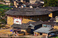 "Chine, Province du Fujian, village de Huaiyuan Lou, maison forteresse en terre et en bois où logent les membres d'une meme famille de l'ethnie Hakka, inscrit au patrimoine mondial de l'Unesco // China, Fujian province, Huaiyuan Lou village, Tulou mud house. well known as the Hakka Tulou region, in Fujian. In 2008, UNESCO granted the Tulou ""Apartments"" World Heritage Status, siting the buildings as exceptional examples of a building tradition and function exemplifying a particular type of communal living and defensive organization. The Fujian Tulou is ""the most extraordinary type of Chinese rural dwellings"" of the Hakka minority group and other people in the mountainous areas in southwestern Fujian."