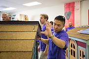 FedEx employee Willis Wah helps others assemble to roof to a nearly finished playhouse at the Habitat For Humanity in Milpitas, Calif., on Sept. 11, 2012.  Photo by Stan Olszewski/SOSKIphoto.