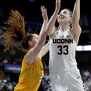 Katie Lou Samuelson, UConn, shoots past Marina Laramie, East Carolina, during the UConn Huskies Vs East Carolina Pirates Quarter Final match at the  2016 American Athletic Conference Championships. Mohegan Sun Arena, Uncasville, Connecticut, USA. 5th March 2016. Photo Tim Clayton