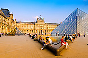 Pyramid and visitors at the Louvre Palace, Louvre Museum, Paris, France