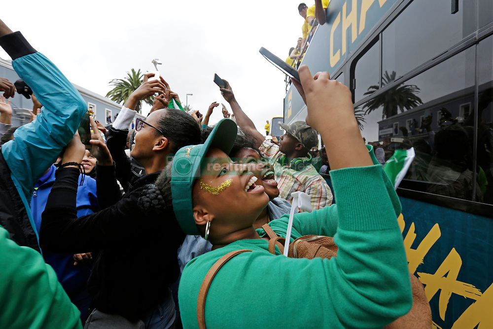 Monday 11th November 2019.<br /> City Hall, Grand Parade,<br /> And City Centre, Cape Town,<br /> Western Cape,<br /> South Africa.<br /> <br /> SPRINGBOKS CELEBRATE WINNING THE RUGBY WORLD CUP CHAMPIONSHIP IN 2019 WITH A COUNTRYWIDE VICTORY TOUR!<br /> <br /> SPRINGBOKS RUGBY WORLD CUP VICTORY TOUR CAPE TOWN!<br /> <br /> Excited fans on Cape Town's Grand Parade take photos and selfies as they celebrate the Springboks driving past in their open top bus near the Cape Town City Hall.<br /> <br /> The reigning Rugby World Cup Champions namely the South African Springbok Rugby Team, celebrates winning the Webb Ellis Cup during the International Rugby Football Board Rugby World Cup Championship held in Japan in 2019 with their Victory Tour that culminated in the final city tour taking place in Cape Town. Thousands of South African fans filled the streets of the city all trying their best to show their support for their beloved Springboks and to celebrate them winning the Rugby World Cup for the third time. South Africa previously won the Rugby World Cup in 1995, 2007 and now again in 2019. South African Springbok Captan Siya Kolisi took the opportunity to speak to the gathered crowd about how something like this brings unity and that we should live together as a nation that practices what is known as ubuntu. Ubuntu is a quality that includes the essential human virtues of compassion and humanity. This image taken in Cape Town on Monday 11th November 2019.<br /> <br /> This image is the property of Seven Bang Media Group (Pty) Ltd, hereinafter referred to as SBM.<br /> <br /> Picture By: SBM / Mark Wessels. (11/11/2019).<br /> +27 (0)61 547 2729<br /> mark@sevenbang.com<br /> www.sevnbang.com<br /> <br /> Copyright © SBM. All Rights Reserved.