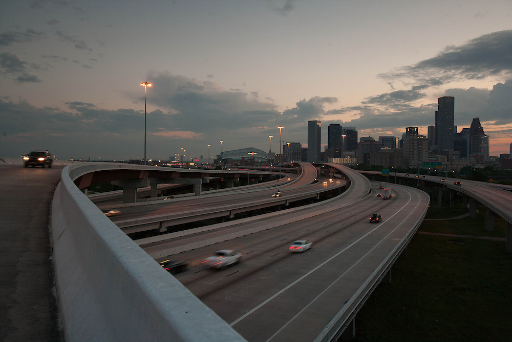 View of the Houston, Texas skyline from a northern freeway at dusk.