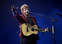 Ed Sheeran performing on the Pyramid stage at Glastonbury Festival, at Worthy Farm in Somerset.