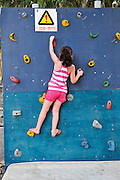 Young girl of six wall climbing Model Release Available