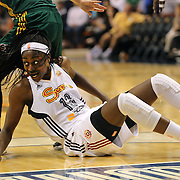 Chiney Ogwumike, Connecticut Sun, falls while challenging for a loose ball during the Connecticut Sun Vs Seattle Storm WNBA regular season game at Mohegan Sun Arena, Uncasville, Connecticut, USA. 23rd May 2014. Photo Tim Clayton