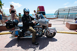 Dave Przgocki stopped at the USA's southernmost point marker, the Buoy in Key West, during the Cross Country Chase motorcycle endurance run from Sault Sainte Marie, MI to Key West, FL. (for vintage bikes from 1930-1948). Riding through town just before at the end of the 110 mile Stage-10 ride from Miami to Key West, FL USA. Sunday, September 15, 2019. Photography ©2019 Michael Lichter.