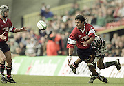 Watford. Great Britain. <br /> Terry FANOLUA, running on the wing passes the ball to Jake BOER, during the Heineken Cup Semi Final; Gloucester Rugby vs Leicester Tigers. Vicarage Road Stadium, Hertfordshire.England.  <br /> <br /> [Mandatory Credit, Peter Spurrier/ Intersport Images].
