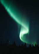 Brilliant green aurora during geomagnetic storm on the night of October 27-28, 2001, Upper Susitna Valley, Alaska.