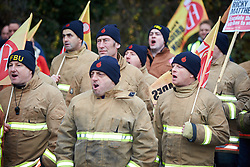 """© Licensed to London News Pictures.  09/12/2014. AYLESBURY, UK. Thousands of fire fighters march through Aylesbury during the latest  nationwide strike of Fire Brigade Union members over pension rights. the union is also intending to take legal action over the dismissal of Ricky Matthews by the Buckinghamshire and Milton Keynes Fire Authority for taking part in pervious industry action. <br /> <br /> In this picture: Firefighters chant """"you don't know what you are doing"""" and """"shame on you"""" outside the headquarters of the Buckinghamshire and Milton Keynes Fire Authority<br /> <br /> Photo credit: Cliff Hide/LNP"""