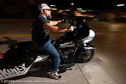 Riding Main Street at night during the Sturgis Black Hills Motorcycle Rally. SD, USA. Saturday, August 10, 2019. Photography ©2019 Michael Lichter.