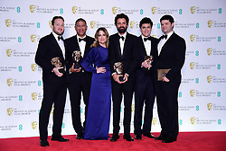 The crew of Spider-Man: Into the Spider-Verse with their Best Animated Film bafta in the press room at the 72nd British Academy Film Awards held at the Royal Albert Hall, Kensington Gore, Kensington, London.