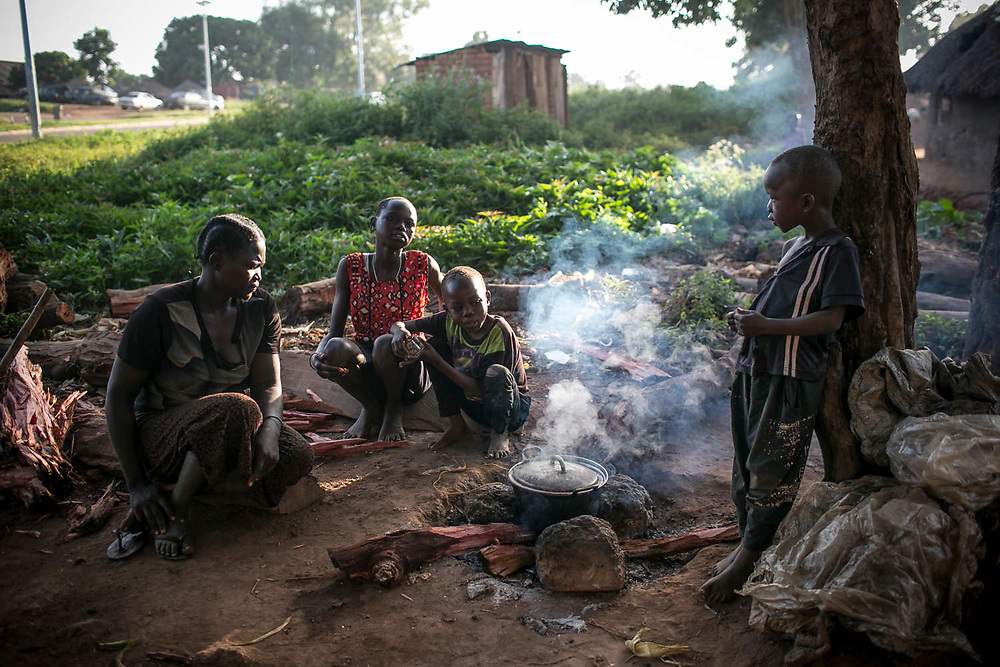 Harriet makes a pot of beans for ten people in her household: her eight children, herself, and an orphan. They don't eat breakfast and eat the pot of beans in midday. Harriet was abducted by LRA at the age of eight in Wiiagwem village in Lira District, and spent 13 years in the bush as a girl soldier and a sex slave. she said her husband, a captain in charge, had four wives. She gave birth to two children in the bush and later had six more from the new husband. The new husband rarely stays with her. She sells boiled corns to support herself and children.