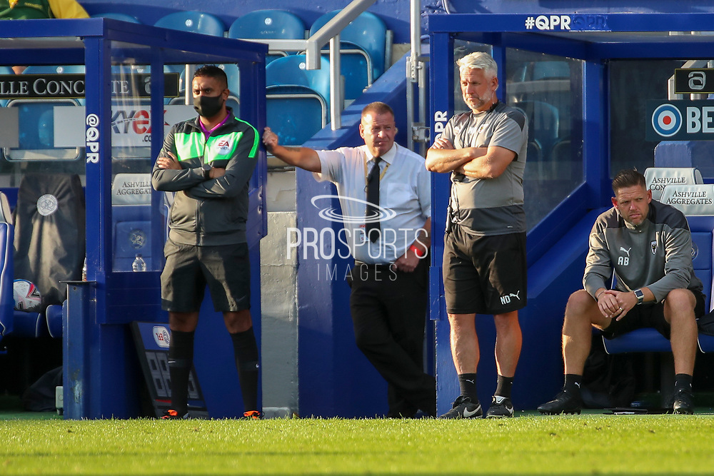 AFC Wimbledon assistant manager Nick Daws and AFC Wimbledon goalkeeping coach Ashley Bayes watching the game from the dug out during the EFL Trophy Group O match between AFC Wimbledon and Charlton Athletic at the Kiyan Prince Foundation Stadium, London, England on 1 September 2020.