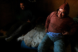 Two Inuit hunters prepare to leave a small hut for a day of hunting on the sea ice which will prove unsuccessful. A changing climate - which shows itself in warming temperatures, earlier summers, later winters, and shrinking and thinning sea ice - threatens the livelihoods and traditions of some of the last subsistence hunters on Earth, the Polar Inuit communities of far Northwest Greenland.