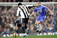 Photo: Marc Atkins.<br /> Chelsea v Newcastle United. The Barclays Premiership. 13/12/2006. Obafemi Martins of Newcastle shoots on goal watched by John Terry of Chelsea.