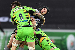 Ospreys' Dan Evans is tackled by Northampton Saints' Teimana Harrison and Mike Haywood<br /> <br /> Photographer Craig Thomas/Replay Images<br /> <br /> EPCR Champions Cup Round 4 - Ospreys v Northampton Saints - Sunday 17th December 2017 - Parc y Scarlets - Llanelli<br /> <br /> World Copyright © 2017 Replay Images. All rights reserved. info@replayimages.co.uk - www.replayimages.co.uk