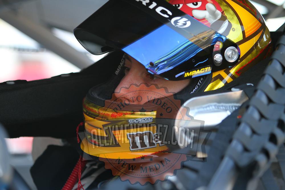 Sprint Cup Series driver Kyle Busch (18) as seen in the side view mirro at Daytona International Speedway on February 18, 2011 in Daytona Beach, Florida. (AP Photo/Alex Menendez)