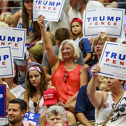 Mechanicsburg, PA – August 1, 2016: Supporters of Presidential candidate Donald J. Trump enthusiastically wave signs at a political rally in Pennsylvania.