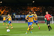 Mansfield Town defender Malvind Benning (3) crosses the ball during the EFL Sky Bet League 2 match between Mansfield Town and Grimsby Town FC at the One Call Stadium, Mansfield, England on 4 January 2020.