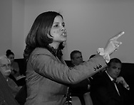 Mineola, New York, U.S. March 5, 2012. MILAGROS VICENTE,  right, pointing finger,of North Valley Stream, calls out after a YES vote by one of the Repubican legislators during Nassau County Legislature vote, which went along party lines, to consolidate 8 police precincts into four.