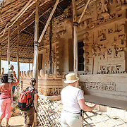 "Tourists admire the carved decorations on the exterior of the Tomb of Ukit Kan Le'k Tok' on top of the Acropolis on the northern side of the Ek'Balam archeological site on Mexico's Yucatan Peninsula. It was once a thriving city of Maya Civilization dating to the Late Classic period. It is 30km north of Valladolid and is named for ""Black Jaguar"" a distinctive motif throughout the site."
