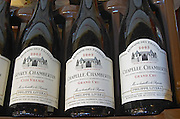 Bottles aging in the cellar.  Chapelle Chambertin and Gevrey. Domaine Philippe Livera, Gevrey Chambertin, Cote de Nuits, d'Or, Burgundy, France