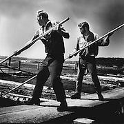 Crewmen use 14-foot aluminum pike poles to sort logs for bundling. (George Carkonen / The Seattle Times, 1970)