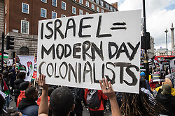 A man holds up a sign as tens of thousands of people take part in the National Demonstration for Palestine from Victoria Embankment to Hyde Park on 22nd May 2021 in London, United Kingdom. The demonstration was organised by pro-Palestinian solidarity groups in protest against Israel's recent attacks on Gaza, its incursions at the Al-Aqsa mosque and its attempts to forcibly displace Palestinian families from the Sheikh Jarrah neighbourhood of East Jerusalem.