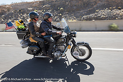 Motorcycle Cannonball insurance sponsor Greg Allen and Pamela Sanwald on Gregs restored BMW as they follow centennial riders from coast to coast on the Motorcycle Cannonball Race of the Century. Stage-13 ride from Williams, AZ to Lake Havasu CIty, AZ. USA. Friday September 23, 2016. Photography ©2016 Michael Lichter.