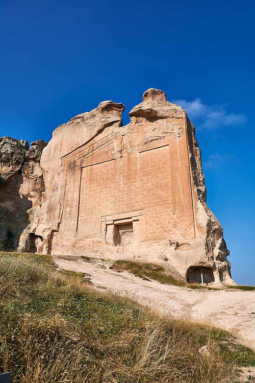 """The Phrygian rock Monument known locally as Yazilikaya, ( written rock ) . 8th - 6th century BC . Midas City, Yazilikaya, Eskisehir, Turkey.<br /> <br /> This is the largest Phrygian rock cut facade monument, measuring 17m x 16.5m. It represents the front of a Phrygian megaron type building with a low pitched roof. It is known locally as yazilikaya , which means """"written rock"""", because of the Paleo-Phrygian inscriptions carved above the rock above the roof outline, down the right side and in the niche. The upper inscription dedicates the monument to King Midas, and so it is also known as the """"Midas Monument"""". The niche probably contained an image of the Phrygian Mother  Goddess, and the word """"Matar"""" (Mother) is inscribed inside. The monument was carved  around the 8th and  6th century BC. .<br /> <br /> If you prefer to buy from our ALAMY PHOTO LIBRARY  Collection visit : https://www.alamy.com/portfolio/paul-williams-funkystock/ancient-midas-turkey.html<br /> <br /> Visit our CLASSICAL WORLD HISTORIC SITES PHOTO COLLECTIONS for more photos to download or buy as wall art prints https://funkystock.photoshelter.com/gallery-collection/Classical-Era-Historic-Sites-Archaeological-Sites-Pictures-Images/C0000g4bSGiDL9rw"""