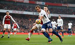 Tottenham Hotspur's Harry Kane battles for possession of the ball with Arsenal's Laurent Koscielny