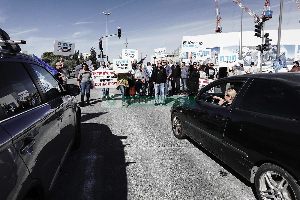 November 18, 2018 - Jerusalem, Israel - Israel Police pensioners, retired prison officers and the Association of Wives of Policemen and Correction Facilities Officers demonstrate in front of the PM's Office demanding government immediately implement a 1979 agreement backed by a 2017 Labor Court ruling ordering they receive a raise in salaries and retirement benefits retroactively. Protesters blocked the main entrance to the PM's Office and occasionally a main junction nearby. (Credit Image: © Nir Alon/ZUMA Wire)