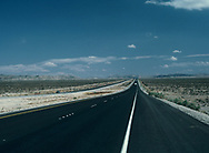 Rural, Utah 1981/03/01 A Straight Road.<br />Photo by Dennis Brack