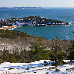 Sand Beach in winter as seen from Gorham Mountain in Maine's Acadia National Park.