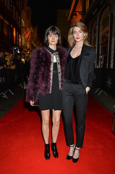 Left to right, SAM ROLLINSON and EVE DELF at the launch of the new Bulgari flagship store at 168 New Bond Street, London on 14th April 2016.