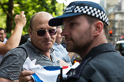 London, UK. 10th June, 2018. A police officer speaks to a pro-Israel activist taunting hundreds of people taking part in the pro-Palestinian Al Quds Day march through central London organised by the Islamic Human Rights Commission. An international event, it began in Iran in 1979. Quds is the Arabic name for Jerusalem.