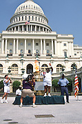 The Olympic torch is carried to the US Capitol building as part of the relay to the 1996 Summer Games in Atlanta June 21, 19967 in Washington, DC.