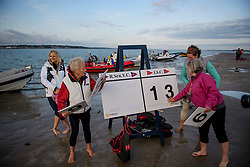 © Licensed to London News Pictures. 24/08/2017. Solent, UK. A group of boat club members keep score. Teams take part in the Brambles Bank Cricket Match in the middle of The Solent strait on August 24, 2017. The annual cricket match between the Royal Southern Yacht Club and The Island Sailing Club, takes place on a sandbank which appears for 30 minutes at lowest tide. The game lasts until the tide returns. Photo credit: Ben Cawthra/LNP