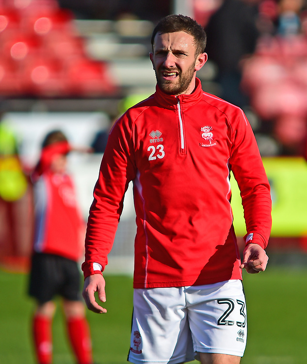 Lincoln City's Neal Eardley during the pre-match warm-up<br /> <br /> Photographer Andrew Vaughan/CameraSport<br /> <br /> The EFL Sky Bet League Two - Crawley Town v Lincoln City - Saturday 17th February 2018 - Broadfield Stadium - Crawley<br /> <br /> World Copyright © 2018 CameraSport. All rights reserved. 43 Linden Ave. Countesthorpe. Leicester. England. LE8 5PG - Tel: +44 (0) 116 277 4147 - admin@camerasport.com - www.camerasport.com